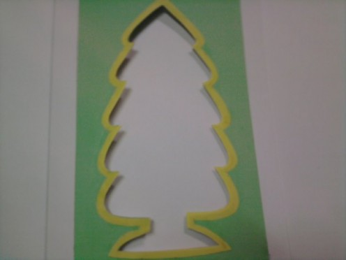 Paste the yellow paper tree outline onto the front card.