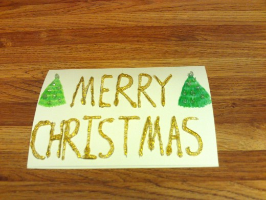 I used gold glitter glue to trace over Merry Christmas.