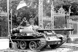 NORTH VIETNAMESE SOLDIER IN A RUSIAN T-54 TANK ROLLING INTO INDEPENDENCE PALACE, SAIGON