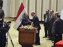 Iraq's President Jalal Talabani shakes hands with newly elected speaker Usama al-Nujayfi on 11 November.2010