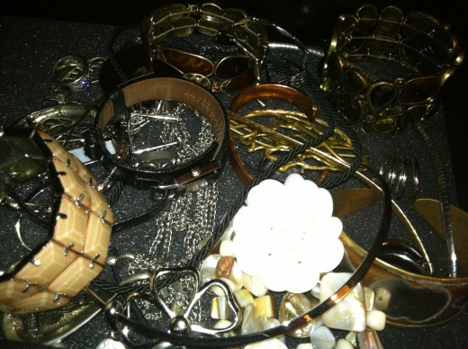 Tangled jewelry in a foam-lined tray. What a mess! And it's bad for the jewelry, too.