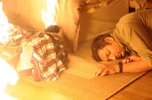 Masood is unconscious as the fire rapidly spreads