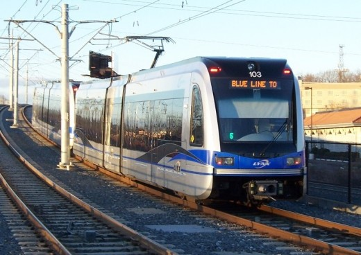 Charlotte light rail train approaches Woodlawn station.