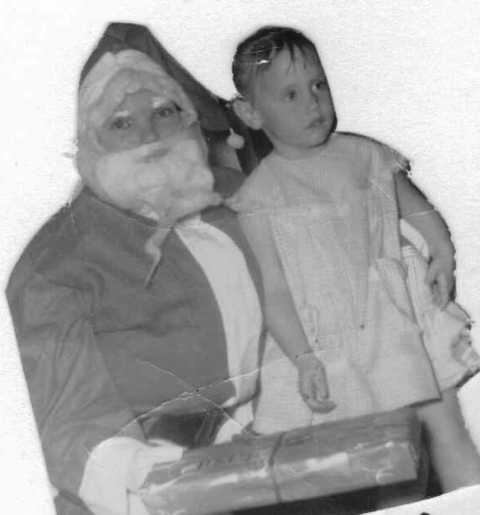 Myself and Santa Claus... Those eyes and that nose.. so familiar..hmmmmmm