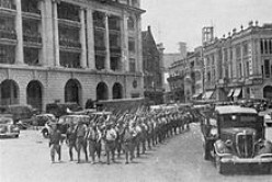 Victorious Japanese troops marching through Singapore City after British capitulation at the Battle of Singapore