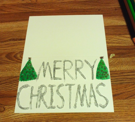 I used silver glitter glue to create this sparkly Christmas card.