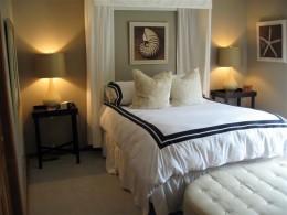 A low-budget basement guest room