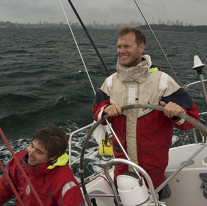 Skipper John Naylor at the helm during a harbour storm. Photo: Mark Dando Read more: http://www.smh.com.au/sport/dark-and-stormy-getting-ready-for-yachtings-everest-20111220-1p3he.html#ixzz1haOEpVqP
