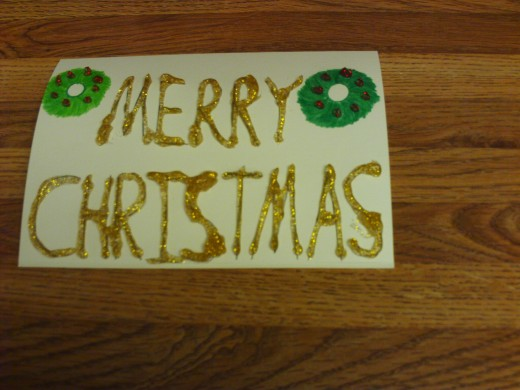 Gold glitter glue was used to decorate the text of the card.