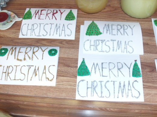Simple accents work well on glitter cards because these allow the sparkly colors to pop.