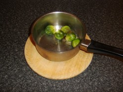 Butter and nutmeg are added to the drained Brussels sprouts