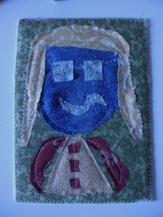 Here's the finished product.  A fabric avatar postcard ready to mail.
