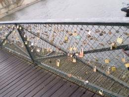 At the Pont des Arts Bridge, you can see many locks. These locks represent a promise of eternal love between couples.