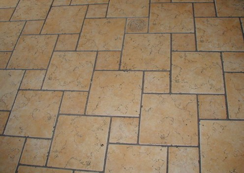 Mud mortar forms a strong base for a ceramic tile floor, and tile floor installations create durable, long-lasting floors.