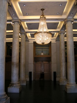 Foyer with marble columns and chandelier