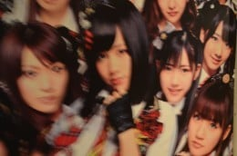 A blurry look at some AKB48 stuff plastered on the walls