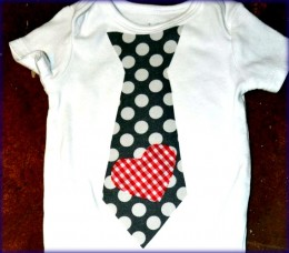 A onesie decorated with fabric applique