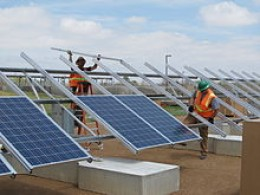 A ground mounted solar panel system installation using precast concrete ballasted footings.