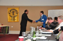 Yours truly, on right, being introduced by the Toastmaster of the evening at my Toastmaster Club.  Yes, it's the same blue jacket, out of mothballs for the first time in an age.