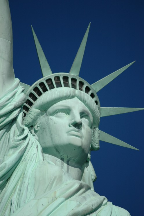 "America's Statue of Liberty: ""Give me your tired, your  poor,  Your huddled masses yearning to breathe free,  The wretched refuse of your teeming shore.  Send these, the homeless, tempest-tossed to me,  I lift my lamp beside the golden door!"""