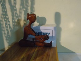 Sculpture of 'mother and child'. This teak wood carving is joint less and  could be folded in 9 different forms to show different postures.