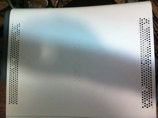 Vents are located on the left and right sides of the Xbox 360's top panel.