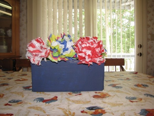 We used this finished centerpiece to decorate the buffet table at a surprise