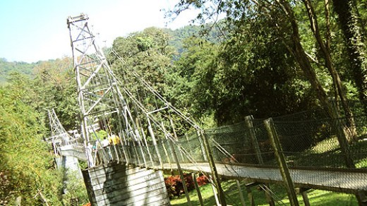 Old suspension bridge over River Mahaweli at the far end of the Garden.