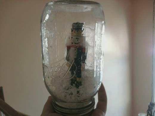 Small, dollar-store nutcrackers are the perfect size for a snowglobe!