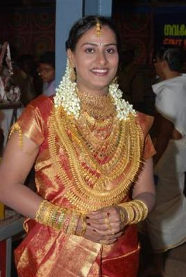 Indian wedding- bride adorned in gold- a typical south indian wedding custom