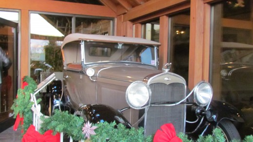 Upon our entrance in the foyer of the restaurant is an antique car.
