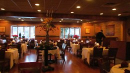 There is a  large spacious dinning area, with romantic lighting scattered about.