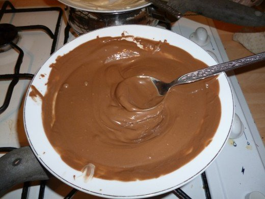 Melt the chocolate over a simmering pan of water, it can be temperamental to work with but it's worth  it.