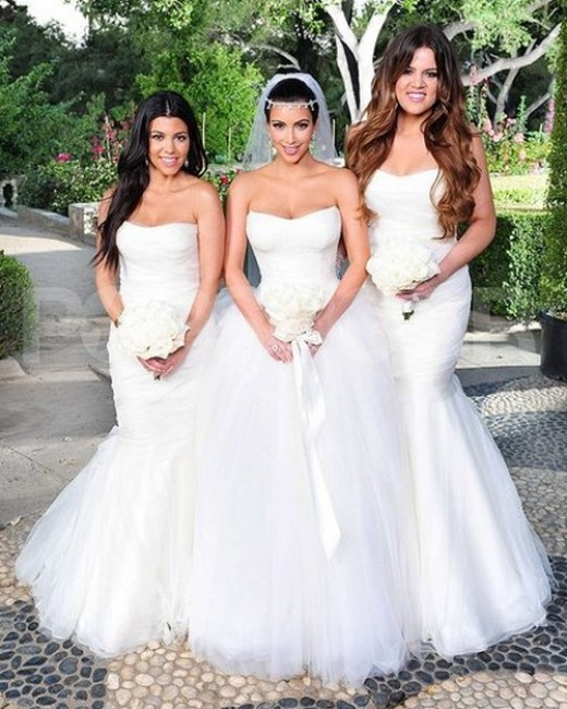 Kim Kardashian in her gorgeous wedding dress with her sisters.
