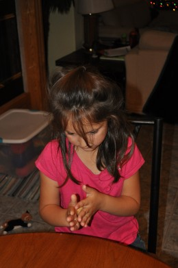 Kids love to help make these. As you can see, she is in deep concentration to make sure they are the perfect size and shape!
