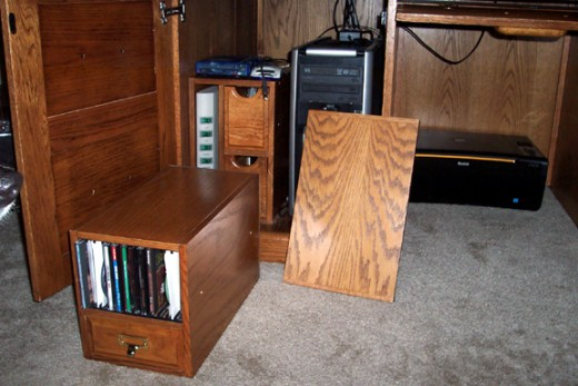 Removed the half width shelf above the CPU and the CD rack & drawer module.