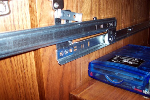 Mount the guide rails so the slide part will be the right distance below the top of the compartment - in this case it placed the shelf drawer six inches below the top of the compartment.