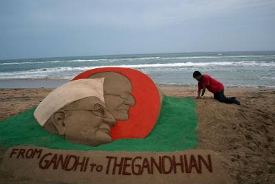 Anna Hazare and in the backdrop Mahatma Gandhi.