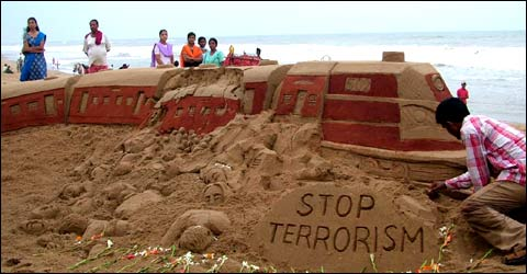 After the train blast in Mumbai, a sand sculpture showing a dismantled train at Puri beach.