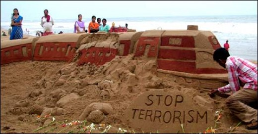 After the train blast in Mumbai, a sand sculpture showing a dismantled train in the Puri beach.