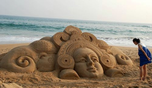 Goddess Durga and two elephants on the adjacent side.