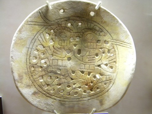 A conch shell gorget with the birdman motif prominently displayed.