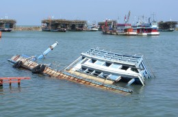 Capsized boat in harbour, Cha Am, Thailand