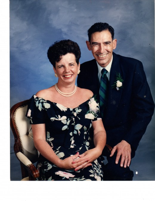 "Me, at forty on the day of my younger daughter's wedding, with my husband, Jim, who still calls me his ""lovely wife"" even now."