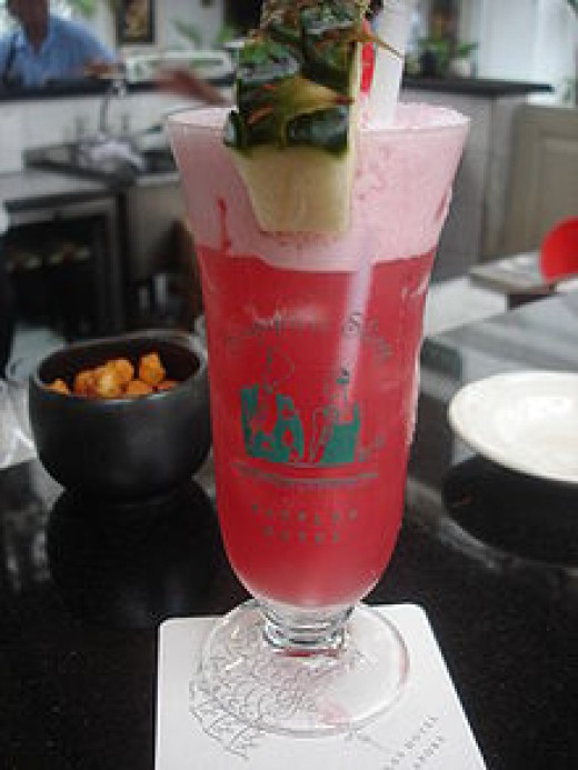 Usually served in a hurricane glass, the sling is a popular combination of Cherry Heering, gin, pineapple juice and Benedictine.  It was invented in Singapore at the Raffles Hotel Bar, about 100 years ago, where the drink is still served today.