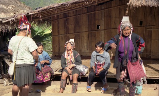 Akha hill tribe women chatting on porch