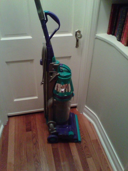 Dyson DC07, complete with shiny duct tape.
