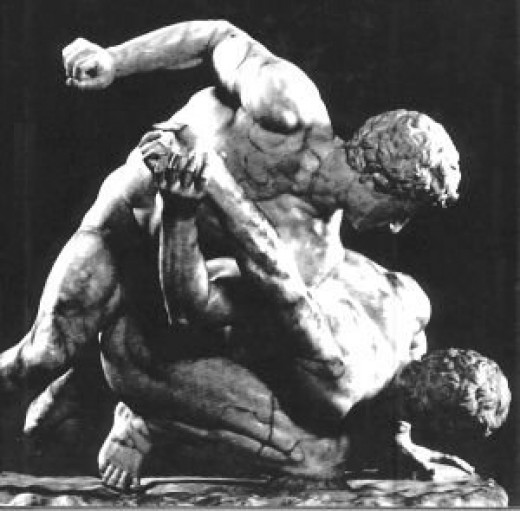 The Pankration united wrestling and boxing in a last man standing scenario of great popularity.  It was very popular in ancient Greece.
