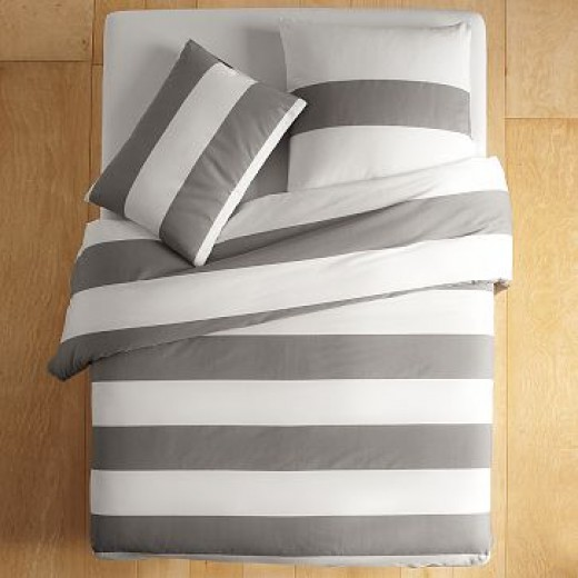 Wide white and gray rugby stripes on a duvet are great for a teenage boy's room.