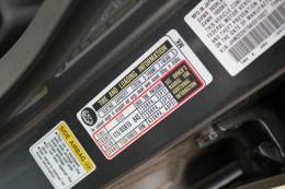 Tire pressure information label inside door frame panel.